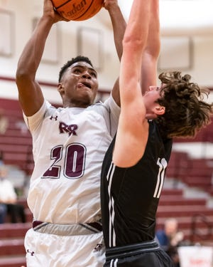 Round Rock senior Jaylen Lee, shooting during a recent game against Vandegrift, aspires to attend college on an academic scholarship. His favorite high school memory is the first time he dunked in a real game.