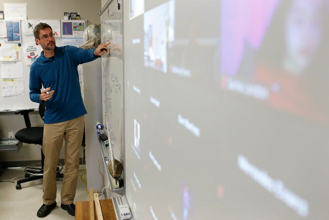 Scott Swain works with his high school physics class at Clarke Central High School in Athens, Ga., on Thursday, Sept. 24, 2020.