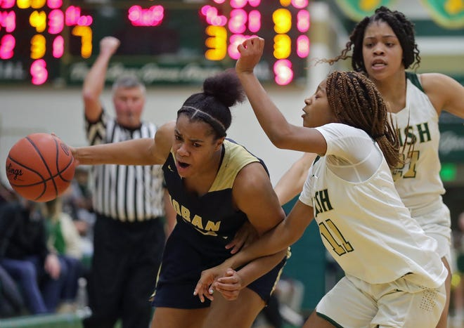 Archbishop Hoban's Lanae Riley, left, drives against St. Vincent-St. Mary's Dream Cherry during the Knights' 56-45 win Thursday night at LeBron James Arena. [Jeff Lange/Beacon Journal]