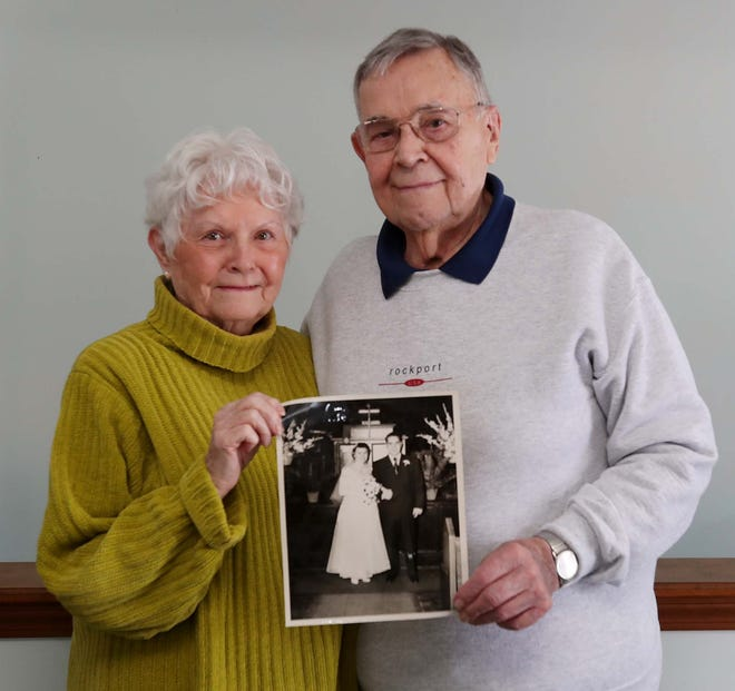 Barbara and John Zohn show a photograph from their 1951 wedding. The Stow couple, who started dating at North High School in 1949, will celebrate 70 years of marriage on March 1.