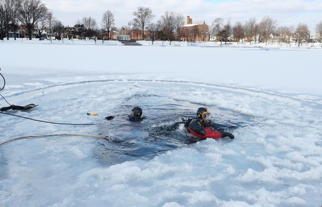 Two members of the Akron Fire Department Dive team take part in a training dive at Lake Anna in Barberton Feb. 5.