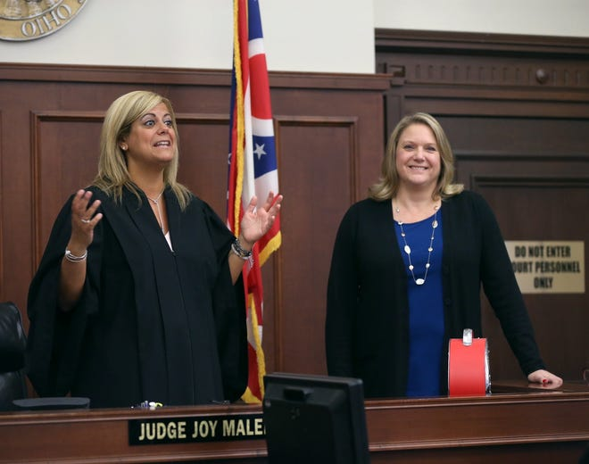 Judge Joy Malek Oldfield, left, introduces newly elected Summit County Common Pleas Judge Susan Baker Ross when she visited her court in April 2019.