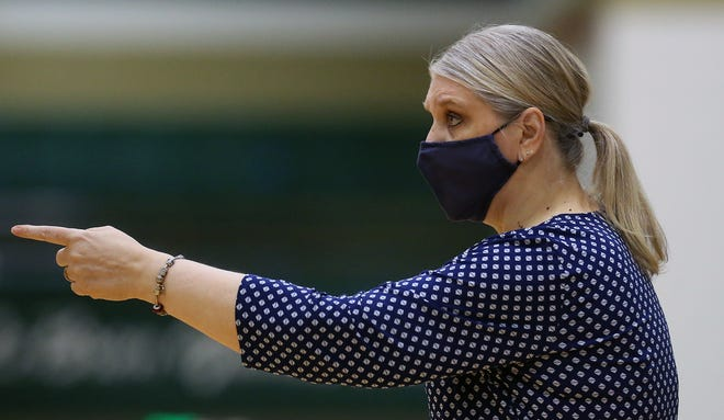Hoban girls basketball coach Pamela Davis credits an improved defensive intensity for the Knights' rise from a good team to one competing in the Division I final four. [Jeff Lange/Beacon Journal]
