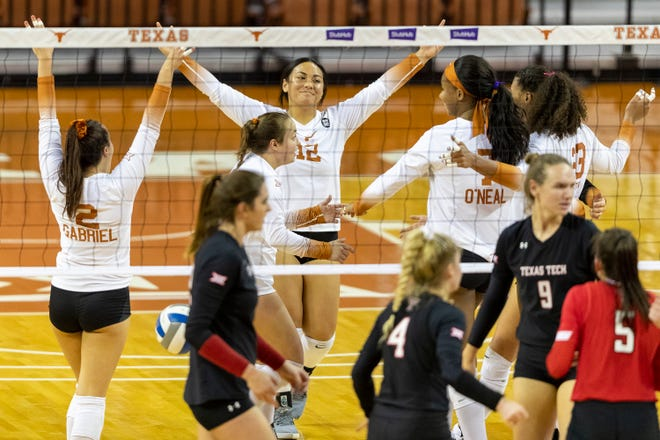 Texas celebrates a point against Texas Tech at the Erwin Center on Oct. 22, 2020.