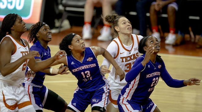 Texas guard Audrey Warren (31) jockeys for position on a rebound against Northwestern State in 2018. As a freshman that year, Warren was part of a recruiting class that ranked second nationally.