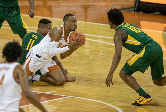 """Texas guard Matt Coleman III grabs a loose ball and looks to pass during Tuesday's 83-69 loss to No. 2 Baylor at the Erwin Center. """"Let's get better, and let's move forward,"""" Coleman said after the defeat."""
