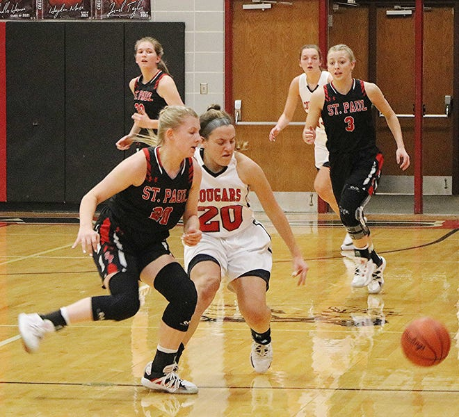 Crestview's Mary Leeper (20) and St. Paul's Molly Ridge (20) chase after a loose ball during the Cougars' 50-47 loss Thursday at Crestview High School.