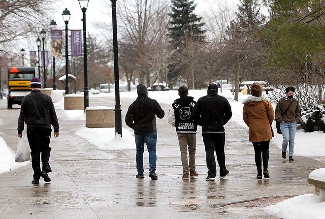 People walk on the quad in the cold at Ashland University on Friday, Feb. 5, 2021. TOM E. PUSKAR/TIMES-GAZETTE.COM