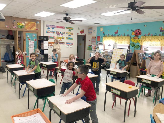 Chelsea Emde's 1st grade students spread shaving cream on their desk tops then had fun writing their spelling words in it.