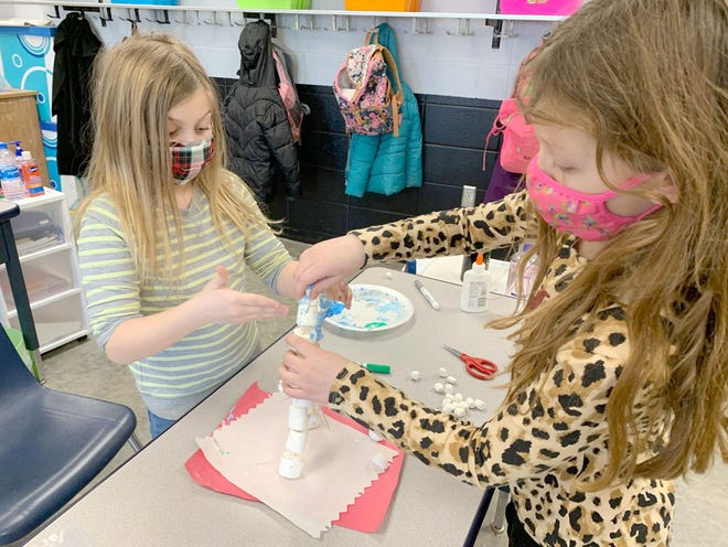 3rd grade students Caroline Fennewald and Evelyn Bishop mix red in with glue to add color to their marshmallow creation on January 29th.