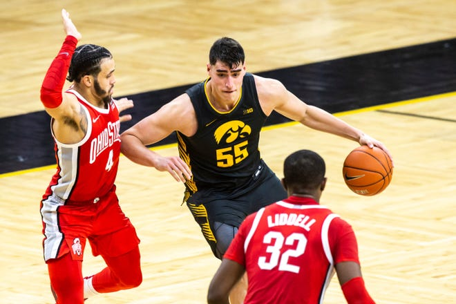 Team defense by the likes of Duane Washington Jr. (4) and E.J. Liddell helped hold all-American Iowa center Luka Garza to a season-low 16 points.