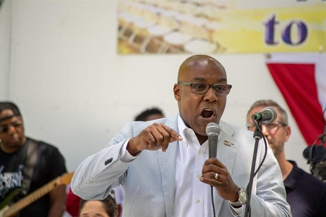 Illinois Attorney General Kwame Raoul speaks at the Illinois State Fair in 2019.