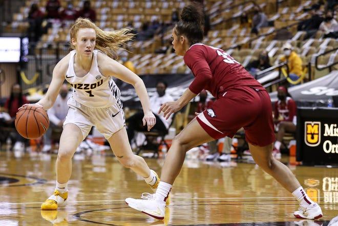 Missouri guard Lauren Hansen (1) dribbles against Arkansas during a game Thursday night at Mizzou Arena.