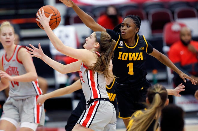 Ohio State Buckeyes guard Jacy Sheldon (4) scores against Iowa Hawkeyes guard Tomi Taiwo (1) during the fourth quarter of their Big Ten game at Value City Arena in Columbus, Ohio on February 4, 2020.