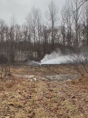 A screen grab from Amber Deem's Facebook video of an oil and gas well spill in Noble County, Ohio.