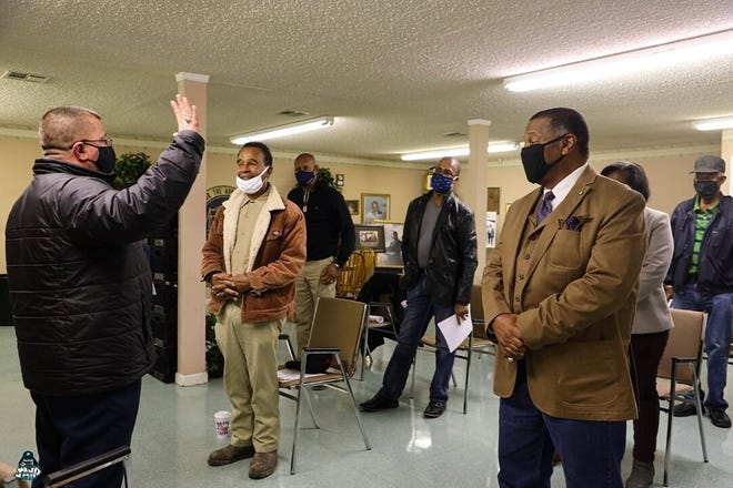 Terrebonne Sheriff Tim Soignet administers the oath of office to officers of the Terrebonne NAACP.