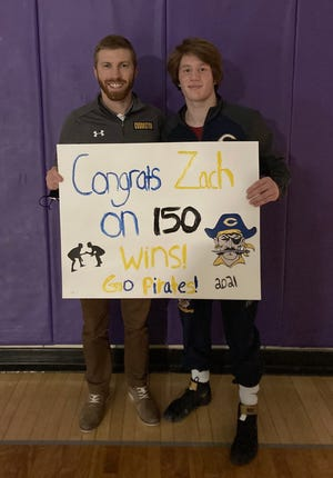 Zach Brown (right) poses with his coach, Wes Hanson, after winning the 150th match of his high school career in Thursday night's match against Dilworth-Glyndon-Felton.