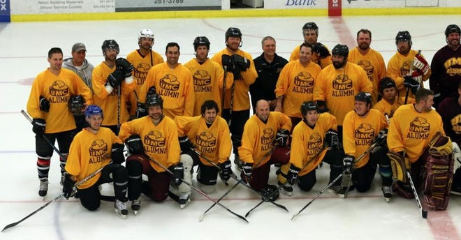 Former Minnesota Crookston hockey players pose for a picture during an alumni game Saturday, Oct. 16, 2016 at the Crookston Sports Center.