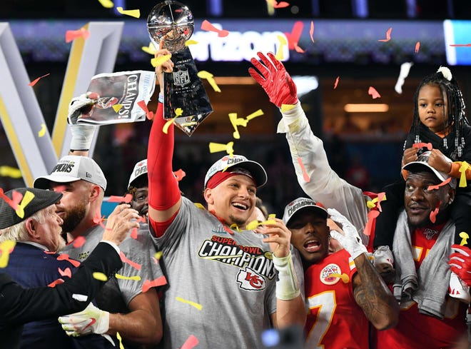 Kansas City Chiefs quarterback Patrick Mahomes hoists the Vince Lombardi Trophy after defeating the San Francisco 49ers in Super Bowl LIV last year at Hard Rock Stadium. Many high school coaches from Lake and Sumter counties believe the Chiefs will repeat as Super Bowl championship when they face Tom Brady and the Tampa Bay Buccaneers Sunday in Super Bowl LV in Tampa. [GANNETT / FILE]