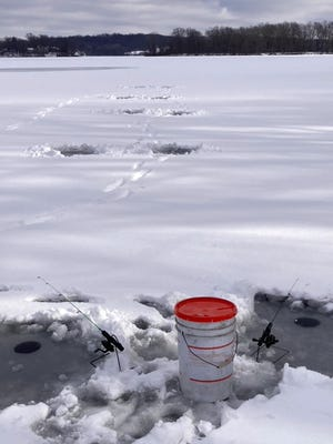 This series of 10 holes is a good way to safely cover an area, drilling and measuring the ice as you go. Fish two holes at a time, and then move on if you don't catch fish.