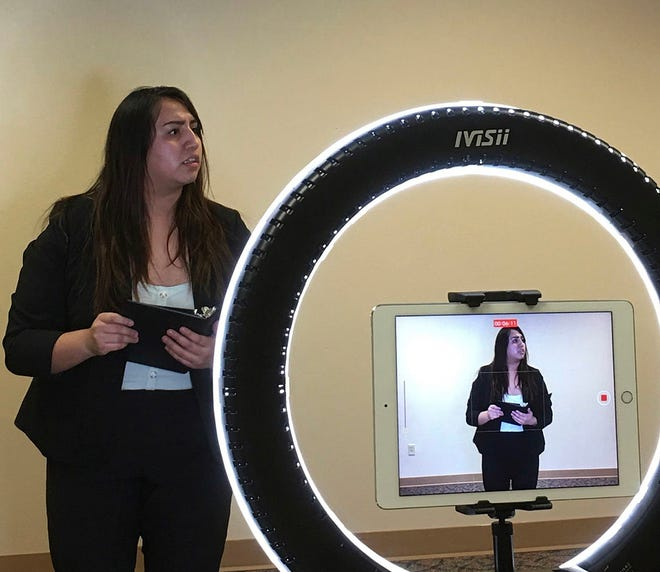 Dodge City High School senior Olivia Ramos performs in the first virtual forensics meet in a tournament hosted by St. Thomas Aquinas.