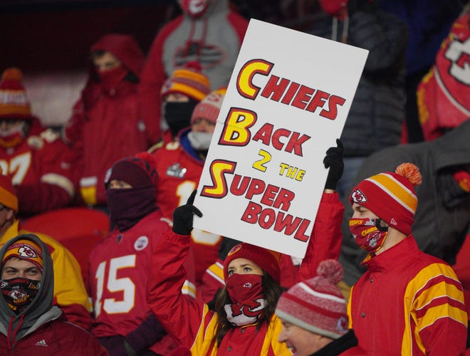 A Kansas City Chiefs fan holds up a sign during the fourth quarter in the AFC Championship game against Buffalo. Even when COVID-19 numbers were spiking around the country, the Chiefs never experienced an outbreak traced back to their fans, and that's a big reason the NFL is allowing fans at Super Bowl 55 Sunday.