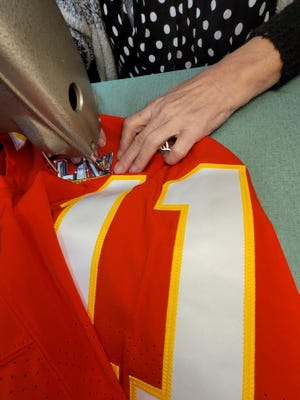 Lynne Obara of the Stitchin Post in Independence sews a Super Bowl LV patch onto one of the Chiefs' jerseys last week. Stitchin Post handled the patchwork for last year's Super Bowl, as well, and has done various sewing work for the Chiefs for several years.