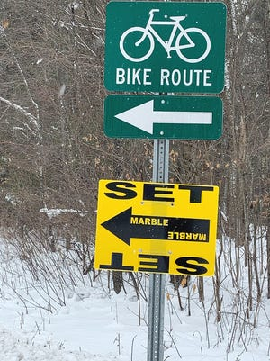 """Signs posted along Kelton Streetand Camp Collier Road in Gardnerindicate that the camp is being used as the """"Marble"""" set."""