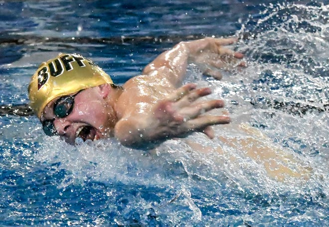Garden City High School's Connor Cupp takes a breath while making a stroke Thursday on his way to winning the 100-yards butterfly during a GCHS swimming quadrangular at the Garden City Family YMCA. Cupp and Devin Chappel each won two individual events at the meet.