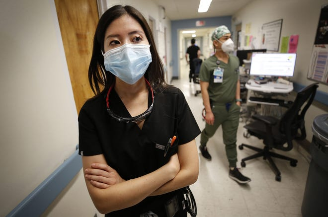 Dr. Christine Choi, a second year medical resident at Harbor-UCLA Medical Center, reflects after spending time tending to COVID-19 patients in the specially constructed secure isolation area on Friday, Jan. 15, 2021 in Torrance, Ca.
