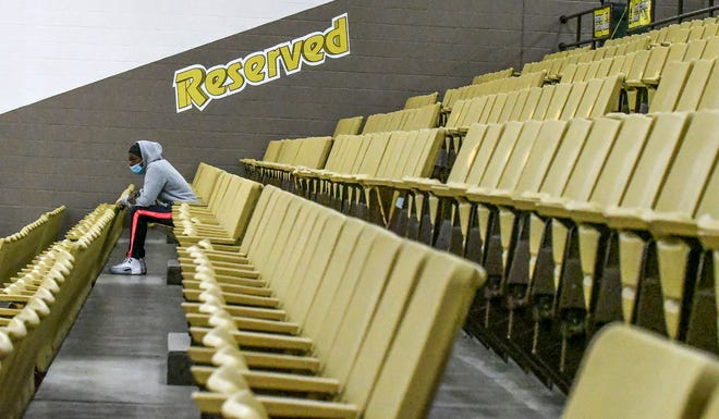 A Garden City Community College students sits amongst empty seating Wednesday during the Garden City men's basketball game at Perryman Athletic Complex. GCCC, in accordance with the Jayhawk Confernce, will be allowing a limited number of fans back to attend basketball games and volleyball matches beginning Feb. 11.