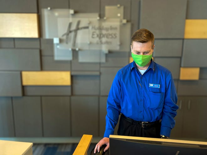 Jacob Orwig, 24, of Avon works at the front desk at the Holiday Inn Express located at 2160 E. Main St. in Galesburg on Jan. 29, 2021.