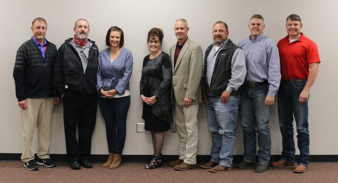 From left, GRISD board members Jeff Hansen, Paul Phillips, Tanya Myers, Marilyn Phillips, new GRISD Superintendent Dr. Trig Overbo, Jason Dillard, Jason Evans and Matt Langford pose for a photo after Overbo officially signed his contract Thursday night.
