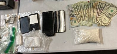 Police display items seized from suspect Scott Lutz following his arrest in Rice County on Wednesday, including 171 grams of suspected methamphetamine.