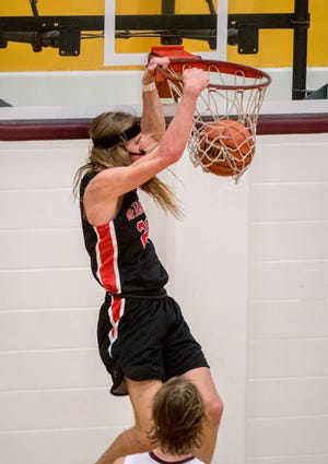 Metamora's Ethan Kizer dunks over a defender during a game last season in East Peoria. Kizer is a 6-foot-6 prospect who has received offers from Bradley and Illinois State.