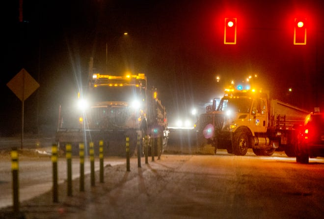 A pair of snow plows turn from Pioneer Parkway onto N. Knoxville Avenue on Thursday, Feb. 4, 2021, in Peoria.