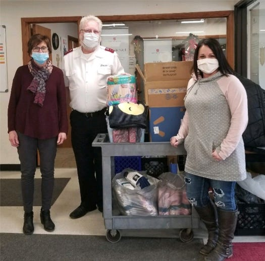 Blackhawk K-Kids adviser Michelle Dorty delivering clothing to Salvation Army representatives Captains Tim and Lisa Thorson from their K-Kids clothing drive. Pictured, from left: Lisa Thorson, Tim Thorson and Michelle Dorty.