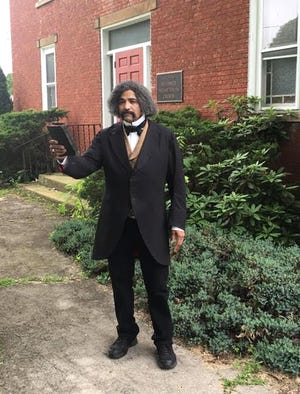 Steven Cole of Ironwood, Michigan portrays Frederick Douglass in front of a church in New Brighton, Pennsylvania. The Freeport native is busy during Black History Month portraying the historical figure that once spoke in Freeport in 1854.