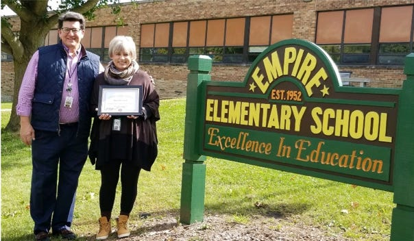 he Golden K Kiwanis recently recognized Mary Palermini for her 15 years of dedicated service as the Empire School K-Kids adviser. Pictured, from left: Nick Connell and Mary Palermini.