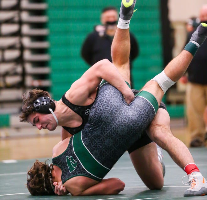 Nordonia 182-pounder Sal Perrine dumps Mayfield's Mason Arth on his back during their match Thursday at Mayfield.