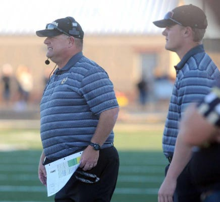 Jimmy Thomas (left) looks on from the sideline as his Bushland team takes on Canadian on Aug. 29, 2014 at Bushland High School. Thomas accepted the head football coach/athletic director position at Littlefield, announced on Wednesday.