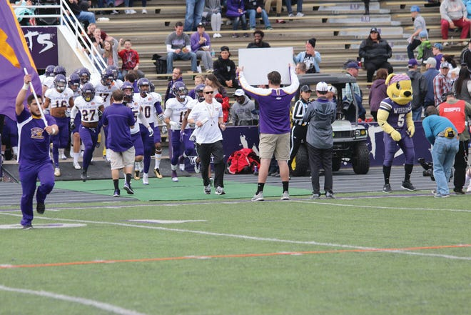 In this file photo, the Western Illinois football team takes the field at Weber State. The game from 2017 was the last playoff game the Leathernecks played.