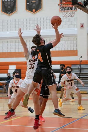 Marlborough senior Jason Short shoots for two points during the game in Maynard on Thursday. The Tigers beat the Panthers, 63-51, that night, but Marlborough got the better of the rematch on Friday.