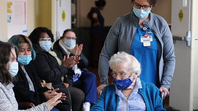Sister Theresa Pond, CSJ, 93, a resident at Bethany Healthcare Center in Framingham, was the first resident to receive a COVID-19 vaccine on Jan. 11, 2021. Framingham officials are concerned that a change in the state's vaccine allotment process will complicate the scheduling of future vaccine clinics.