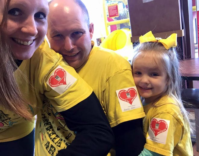 KEYS Kid Amelia Nobis and her parents Chantelle and Pete wear their hearts on the sleeves for kids impacted by cancer. The KEYS Program's annual Wear Your Heart on Your Sleeve Weekend is Feb. 26-28 and stickers are on sale now for $2.50 each.