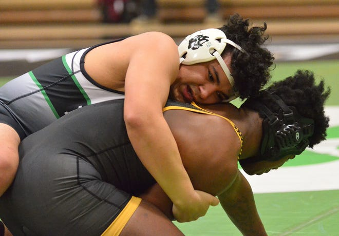 Van Buren senior Seth Villeneuva wrestles against a Lake Hamilton opponent during a match at Clair Bates Arena. Villeneuva and the rest of the Van Buren Pointer wrestlers head to Greenwood on Saturday, Feb. 13, 2021, for the 5A West Conference meet.