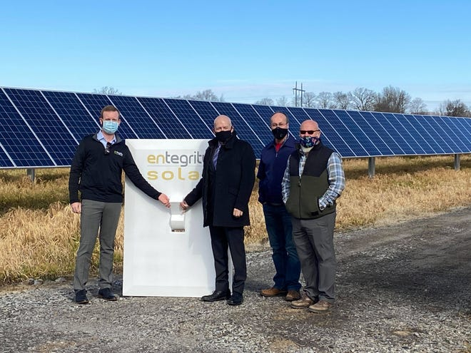 """Sam Selig, Jerry Martin, Mark Yardley, and Raymond Harvey """"flip the switch"""" to commemorate the completion of Phase 1 of Alma's solar project on Feb. 5, 2021."""