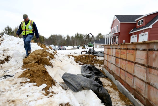 Code Enforcement Officer Tim Metivier checks on a construction site in Somersworth Thursday, Feb. 4, 2021, saying the city is attracting more Seacoast residents and developers who used to look elsewhere.