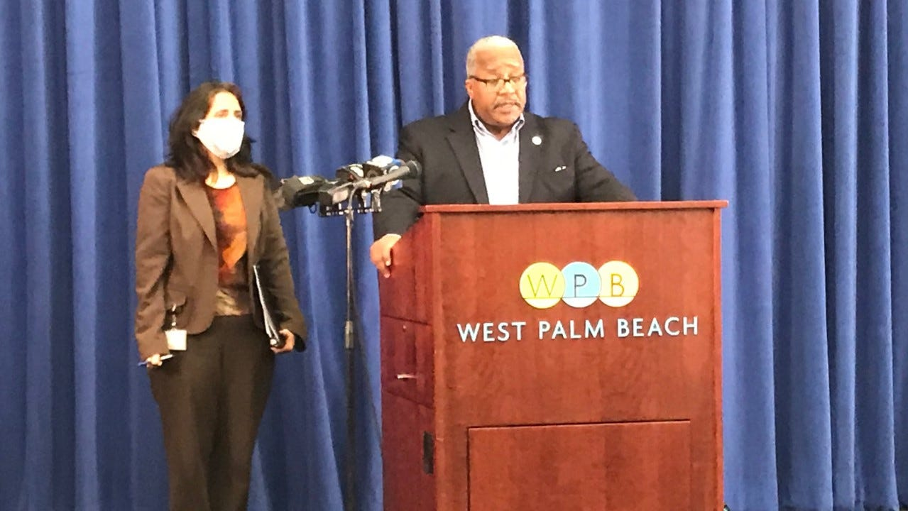 West Palm Beach Utilities Director Poonam Kalkat, left, with Mayor Keith James, at a media conference in city hall Friday morning.