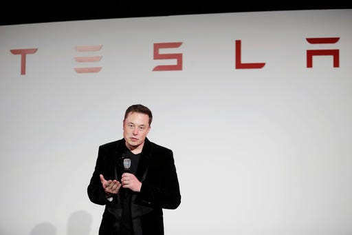 In this Tuesday, Sept. 29, 2015, file photo, Elon Musk, CEO of Tesla Motors Inc., talks during a news conference at the company's headquarters in Fremont, Calif. Musk said Sunday, Sept. 11, 2016, the electric car company is making major improvements to the Autopilot system used by its vehicles, which will dramatically reduce the number and severity of crashes they re involved in. (AP Photo/Marcio Jose Sanchez, File)